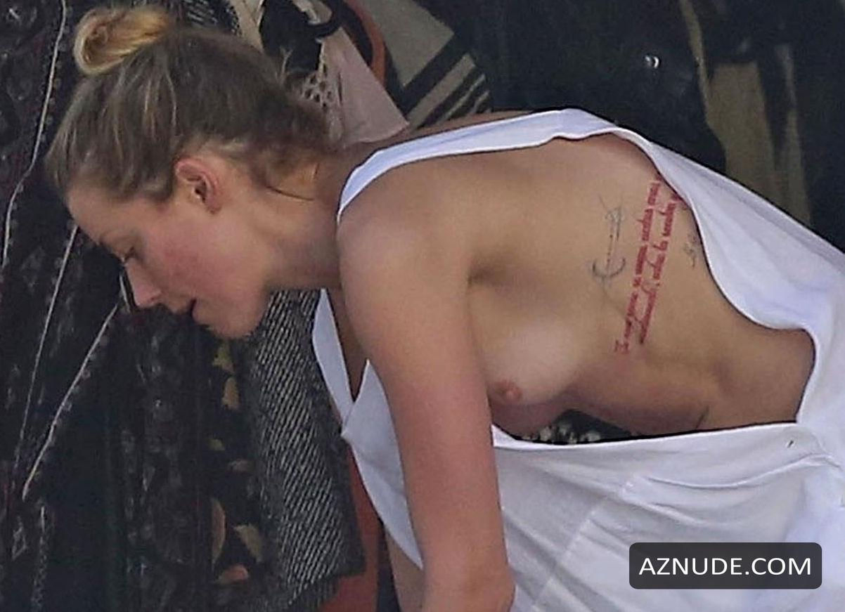 Amber Heard Topless amber heard nip slip exposes boob while cleaning out her