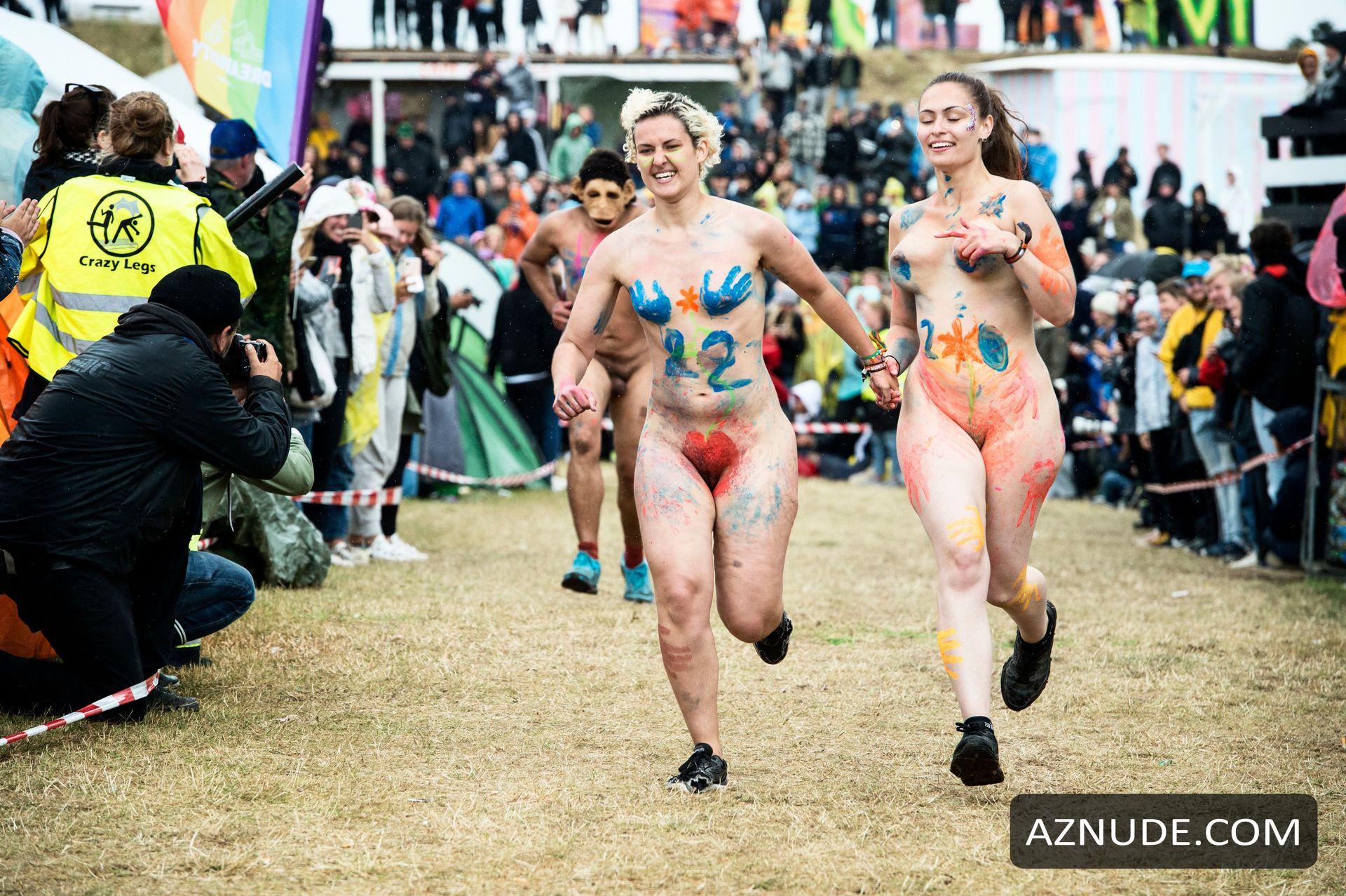Runers take part during annual nude race editorial stock photo